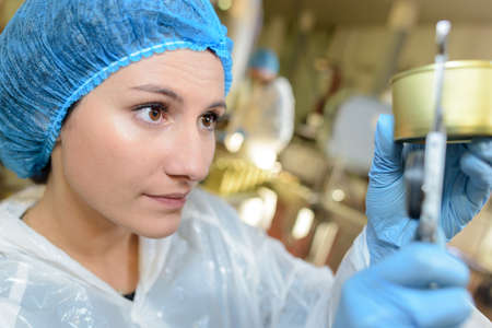 young woman working at the factory Stock Photo