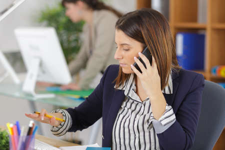 female office worker having a conversation on the phone