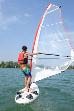 windsurfing on a lake