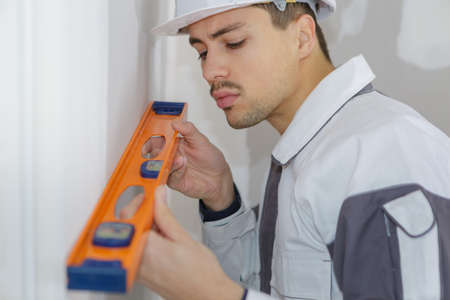 builder with level Stock Photo