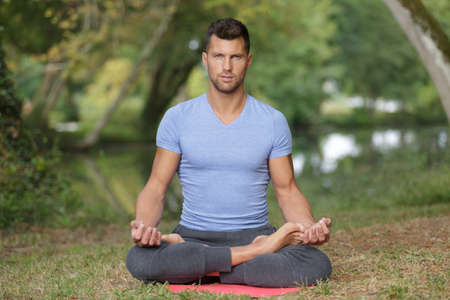 young handsome man meditating Stock Photo