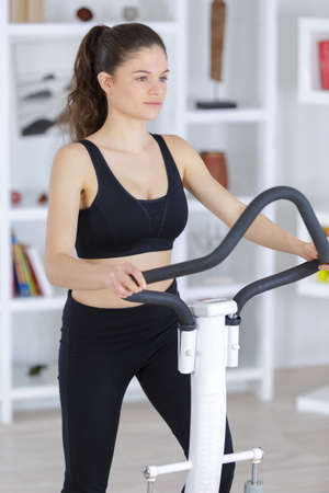 portrait of beautiful sporty young woman doing exercise