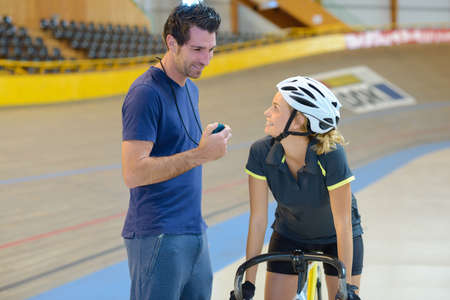 female cyclist talking to the coach