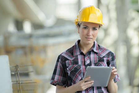 woman wearing helmet in metal factory