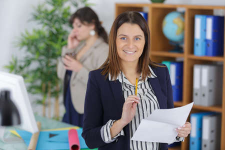 female office looking at camera
