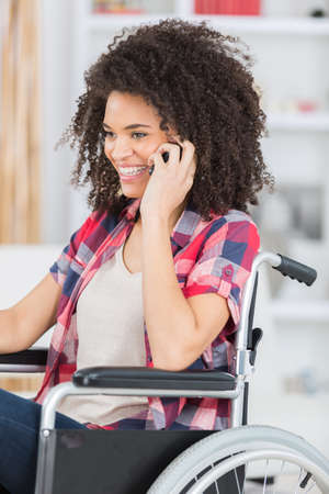 happy beautiful disabled woman using her phone