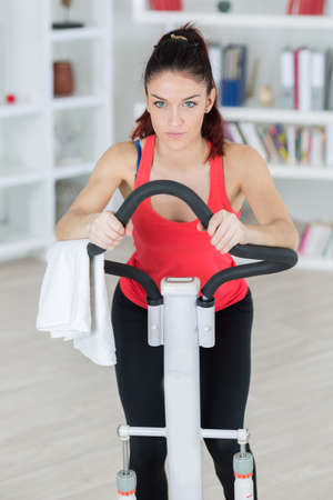 systemic: young woman on an exercise machine