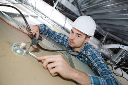 electrician repairing ceiling light Stok Fotoğraf - 88475955
