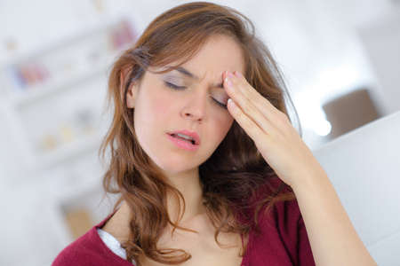 woman tired suffering from head pain