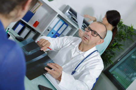 male radiologist talking to patient about x-ray