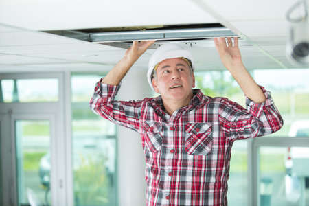 man install suspended ceiling in house