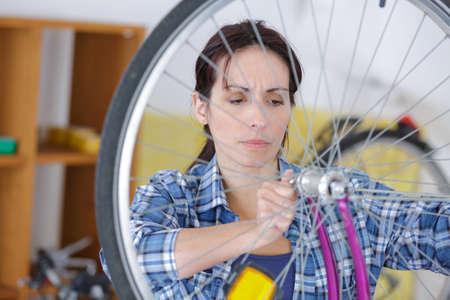 wheel bike technician Stock Photo