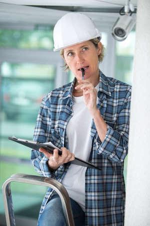 female professional cctv technician working Stock Photo
