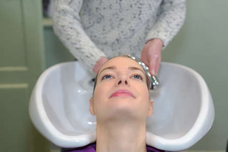 woman having her hair washed in a salon Stock Photo