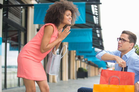 woman begs her boyfriend to continue shopping