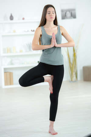 beautiful girl is engaged in yoga Stock Photo