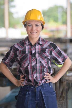 handywoman: female construction worker posing Stock Photo