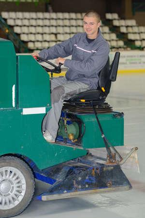 Resurfacing machine cleaning ice at the hockey rink Stock Photo