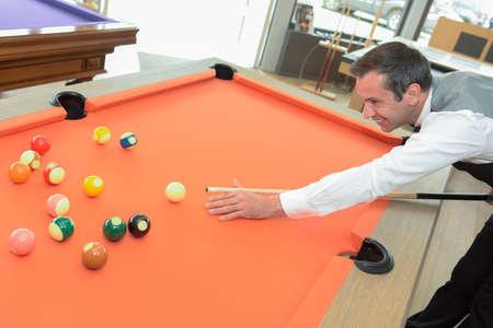A man playing billiards Stock Photo
