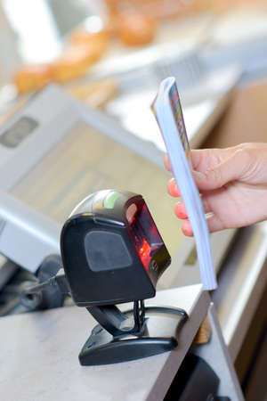 librarian scanning barcode