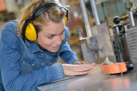 young female carpenter in safety equipment Stock Photo
