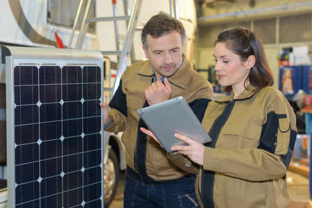 Two technicians considering the alternative energy Stock Photo