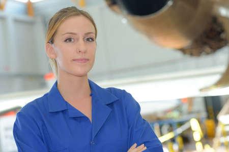 A female mechanic in a repair garage