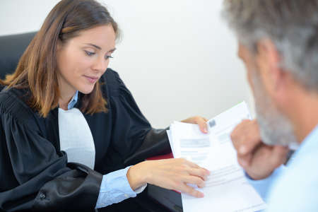 A female lawyer examining a document