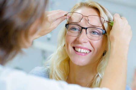 A woman knowing the right frame of her glasses Stock Photo
