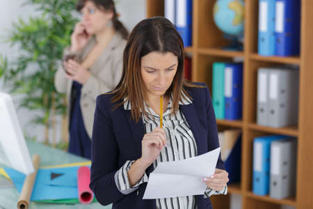 processors: A female office worker checking a document