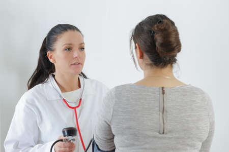 A female doctor consulting her female patient