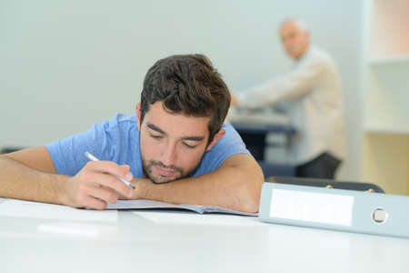 young man taking an exam