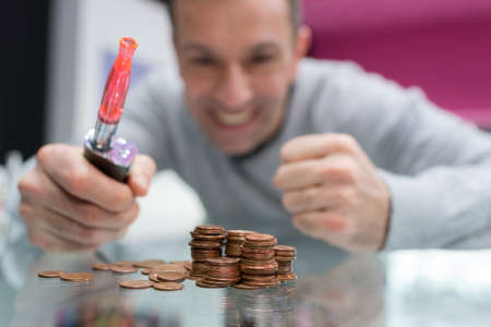 A happy man saving money by quitting smoking for vaping Stock Photo