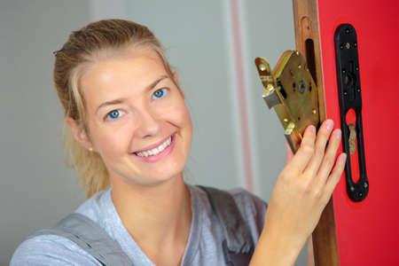 Technician changing the door lock