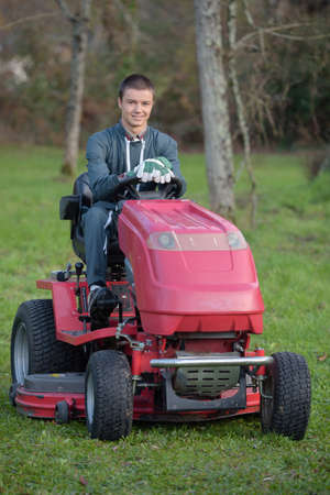 Portrait of man driving mower
