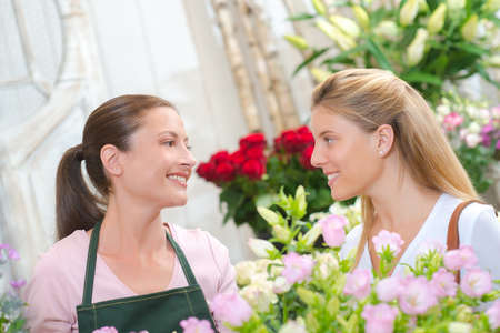 Woman buying some flowers Stock Photo