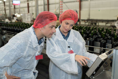 two factory employees in coats Stock Photo