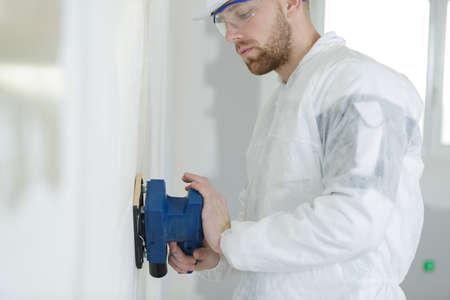 male plasterer polishing the wall