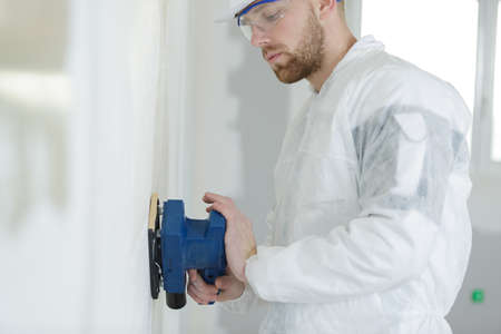 male plasterer polishing the wall