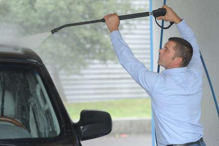 cleaning car using high pressure water Reklamní fotografie