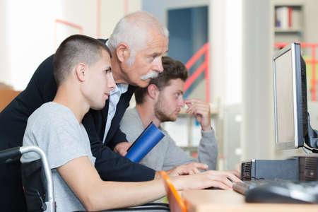 technology and computer teacher Stock Photo