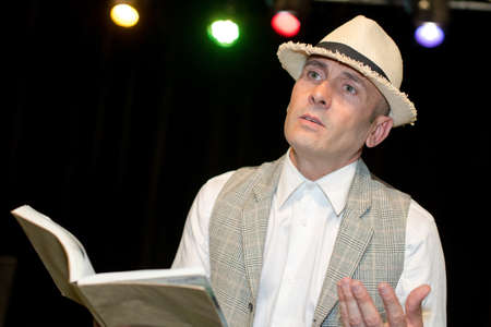 Man reading poetry on stage