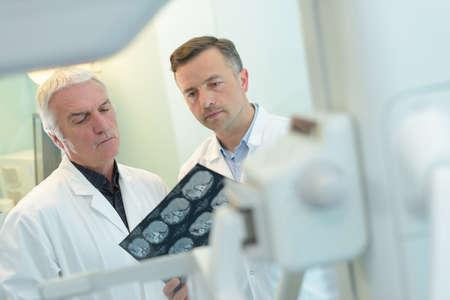 two doctors examining an x-ray Stock Photo