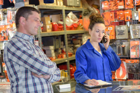 female shop assistant helping customer