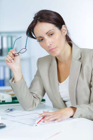 doubtful businesswoman Stock Photo