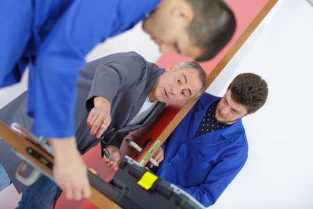 apprentice of door maker Stock Photo