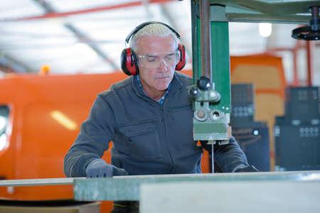 senior metalworker operating cnc milling machine Stock Photo