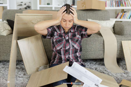 worried confused woman moving into new apartment