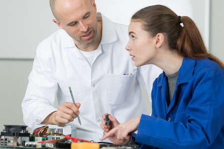 female electronic apprentice with teacher Stock Photo