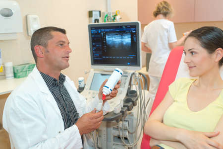 young woman viewing an ultrasound result Stock Photo